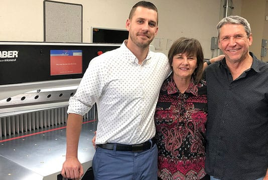 Three owners of a new SABER-X15 paper cutter