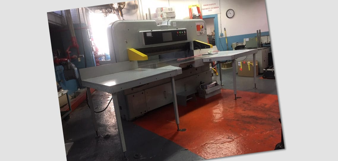 A reconditioned 61-inch Polar paper cutter at Albert Paper Products