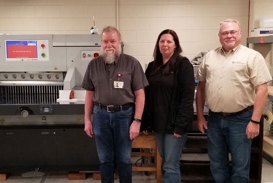 St. Camillus team pose with the new PRISM 80 paper cutter