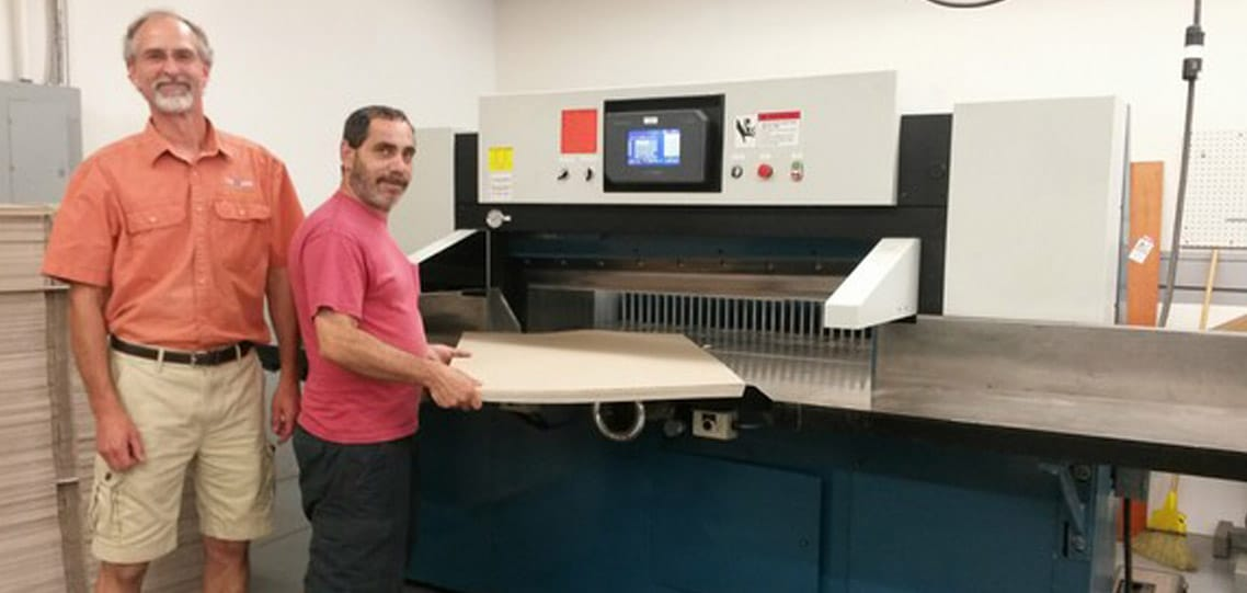 Working with a rebuilt 52 inch Lawson heavy duty paper cutter