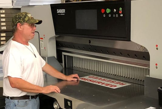 Farmer Signs new SABER industrial paper cutter
